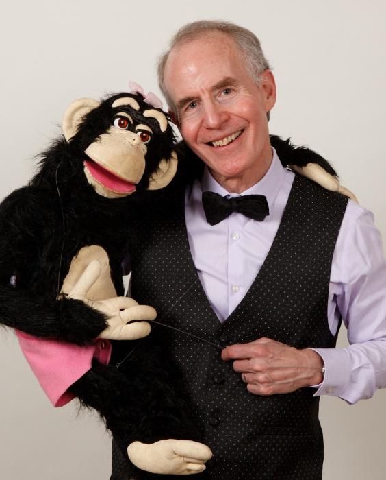 Award winning Ventriloquist & Puppeteer Mark Hellerstein holding Monkey Puppet